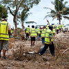 Tsunami relief  for Samoa. Members of the New Zealand Army medical and Engineers staying in village of Lalomanu, Samoa, help local police, NZ Police and other volonteers from the Australian Fire Brigade Seach and Rescue in looking for bodies among the rubble and debris of the Tsunami. Credit: NZDF