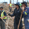 37 Tsunami relief  for Samoa. New Zealand Police Officers helps local Police, New Zealand Defence Personnel and Australian Fire services in searching for bodies buried among the rubble and debris of the destruction caused by the Tsunami. NZ Police Officer talking to Australian Fire Seach and rescue with local police helper. Credit: NZDF