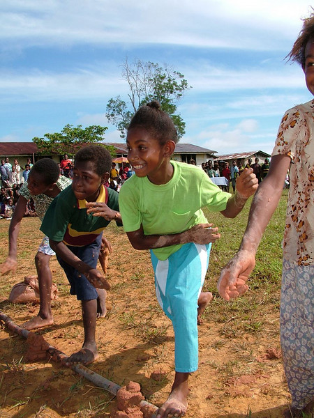 School children having a mud throwing competition, Papua New Guinea. Credit: New Zealand Ministry of Foreign Affairs and Trade