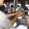 Man grinding coconut, Samoa. Credit: New Zealand Ministry of Foreign Affairs and Trade