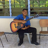 Local boy playing the guitar at Mitiaro Island School - eastern outer island, Cook Islands. Credit: New Zealand Ministry of Foreign Affairs and Trade