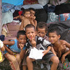 Kids playing amid the relief supplies after the Oct 2009 earthquake and tsunami, Samoa. Credit: New Zealand Ministry of Foreign Affairs and Trade