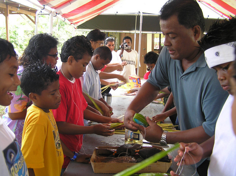 Children learn the traditional skill of wrapping fish in leaves, Palau. Credit: New Zealand Ministry of Foreign Affairs and Trade