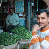 Man selling vegetables at a market in Shimla, India. Credit: Felicity Roxburgh