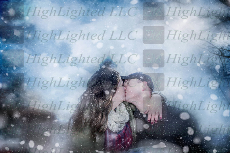Hope and Eric Kissing Snow (1 of 2)