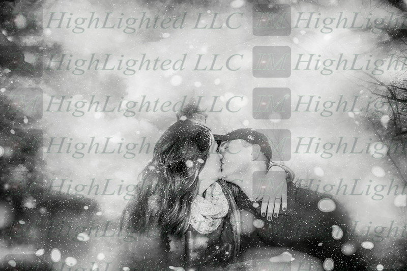 Hope and Eric Kissing Snow (2 of 2)