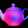 Painting with light: A row of teapots