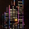 Colorful highrise building at night