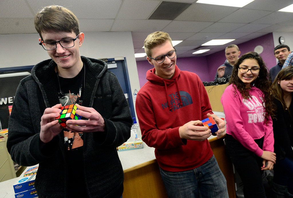 . BROOMFIELD, CO - DECEMBER 4, 2018 Bollman Technical Education Center students Heath Rohlman, left and Luke Hymas race to finish a Rubik\'s Cube in front of a 2nd grade class at Centennial Elementary School as part of Computer Science Education Week in Broomfield on Tuesday morning. Fellow student Amairany Venzor looks on at right.  For more photos go to broomfieldenterprise.com (Photo by Paul Aiken/Staff Photographer)