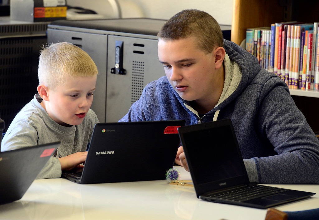 . BROOMFIELD, CO - DECEMBER 4, 2018 Centennial Elementary School second grader Christopher Janke works on computer programming with Matthew Lindeman of Bollman Technical Education Center as part of  Computer Science Education Week at the school in Broomfield on Tuesday morning.  For more photos go to broomfieldenterprise.com (Photo by Paul Aiken/Staff Photographer)