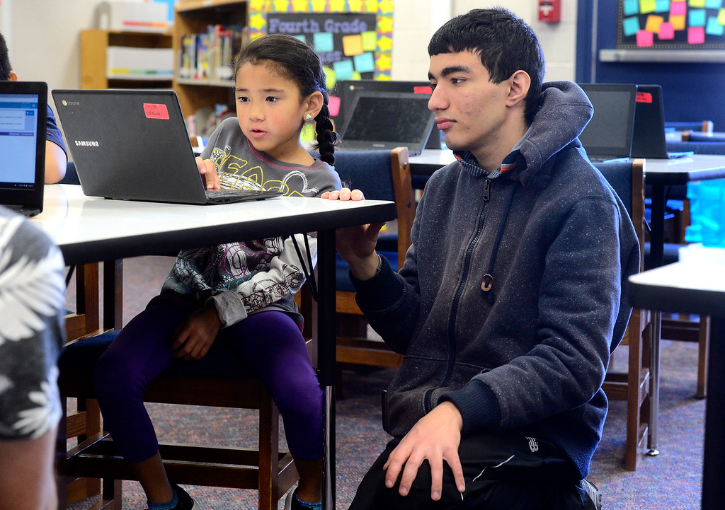 . BROOMFIELD, CO - DECEMBER 4, 2018 Centennial Elementary School second grader Xyla Diaz, works on program coding with Arif Eroglu of Bollman Technical Education Center as part of Computer Science Education Week at the school in Broomfield on Tuesday. For more photos go to broomfieldenterprise.com (Photo by Paul Aiken/Staff Photographer)