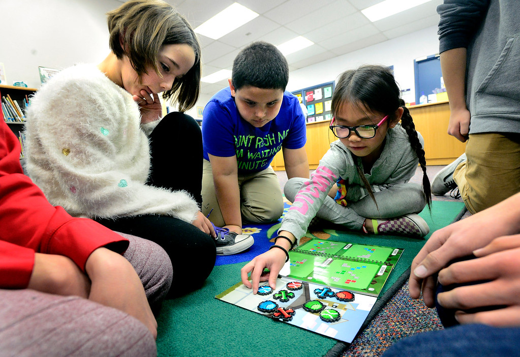 . BROOMFIELD, CO - DECEMBER 4, 2018 Centennial Elementary School students from left to right, Julianna Andrews, Jesus Quezada, and Aaliyah Vue work on a puzzle game with Bollman Technical Education School students as part of Center Computer Science Education Week at the school in Broomfield on Tuesday. For more photos go to broomfieldenterprise.com (Photo by Paul Aiken/Staff Photographer)