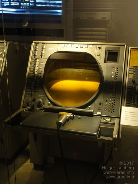 Terminal with light gun of the 1958 - 1983 SAGE defense system used by NORAD. Note the built-in ashtray and cigarette lighter on the lower left near the two large nobs. (Computer History Museum, Mountain View)