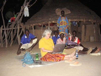 Blogging in front of the women's house in Yel's compound.