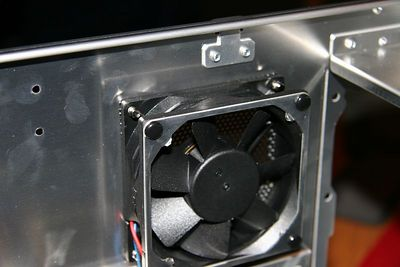 The rear 80mm fan with fan guard removed from the inside to improve air flow.