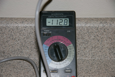 DC voltage being displayed on a volt meter. Once the capacitor is added this should be 115vdc.