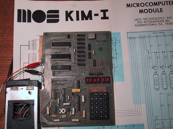 A famous microprocessor devellopment kit: the KIM-1 (1978).<br /> It's considered the 'granddaddy' of microprocessor systems.<br /> Built around the MOS 6502 CPU (1 Mhz)<br /> A 'whopping' 1024 bytes of RAM, and a HEX keypad.<br /> Mine is neatly enclosed by a nice plexiglass box, and it now works as a clock!!<br /> You could connect a Cassette tape recorder to save and restore the programs...<br /> I still have the tapes!!!