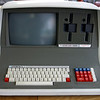 """The Superbrain-II, from Intertec Data Systems.<br /> I bought it in 1981.<br /> I paid around 10 grand (in Dutch Guilders)<br /> I must have been totally out of my mind I guess..<br /> But it gave me a lot of experience with computersystems and software.<br /> IThe SuperBrain was a dual Z80 cpu machine (one Z80 cpu for disk-I/O, and the other Z80 cpu for the OS)<br /> <br /> I was making databases using DBASE II (Ashton Tate) for my dads company using this machine.<br /> Powerful machine for that time.<br /> The two red keys (left and right) of the main keyboard had to be pressed simultaneous for a reboot.<br /> The silly thing in the design was, that the floppies were ALWAYS running.<br /> I modified it, and that was a good thing.<br /> There was even a magazine for the Superbrain (bimonthly: SuperLetter), and I  wrote several articles for it.<br /> I had even changed the BIOS Eprom, and installed SUPERbios.<br /> <br /> Check it out, in a YouTube video:<br /> <a href=""""https://www.youtube.com/watch?v=8az49vFr4sY"""">https://www.youtube.com/watch?v=8az49vFr4sY</a>"""