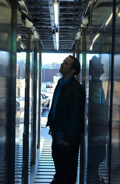 Project Blackbox, Washington DC, Doug looking into the side of the cut away rack