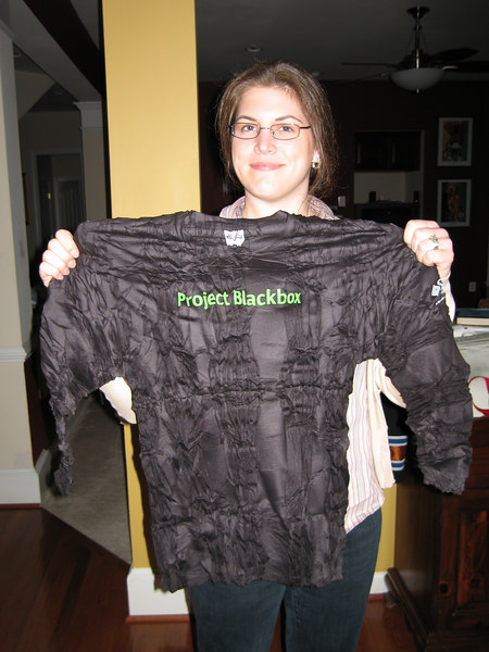 Project Blackbox, Washington DC, swag, C- holds an incredibly wrinkled T-shirt