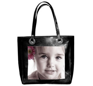 "Tote_02, $175.00 Finished in baby blue, light pink or black patent leather, your photo appears on a sturdy and durable canvas. The 14""x14""x4"" tote also features an inside zip pocket, cell phone holder, and water bottle holder.  Color photos are recommended for this bag."