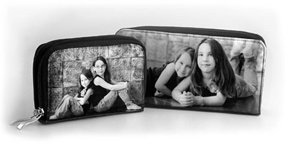 "Each wallet features a photo of your choice on both sides.  The wallets have two separate zippered compartments, plus an inside zippered coin pouch, plenty of room for credit cards, cash, and an ID window.   Wallet_01 (checkbook size 4"" x 7 1/2""):  $112.00 Wallet_02 (medium 3 3/4"" x 5 1/4""):  $88.00"