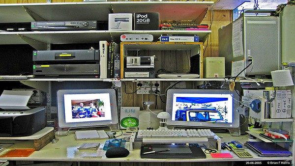 Brians Apple Mac G-5 dual LCD screen computor setup in his DotCom at Buffalo in Daniels Street. Note Wacom USB tablet for Photoshop editing use.