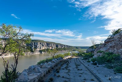The Old Road along the Pecos River flowing into the Rio Grande in the distance.