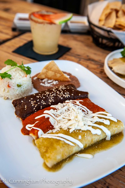 Chicken Enchiladas~three corn tortillas stuffed with marinated shredded chicken.  Green tomatillo sauce, red guajillo, sauce, mole sauce.