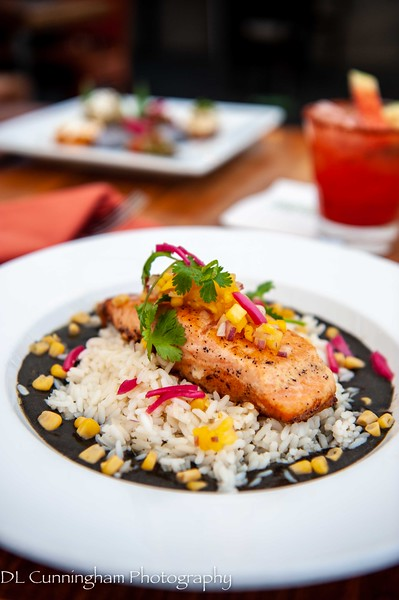 Salmon en Huitlacoche~Grilled then baked salmon on a bed of huitlacoche sauce, corn on top of white rice.
