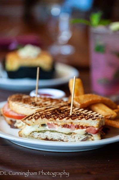 Jalapeno Turkey Melt - house-roasted distal turkey, jalapeño aioli, smoked mozzarella, roasted jalapeno, carmelized onion and tomato on sourdough panini and hibiscus mimosa