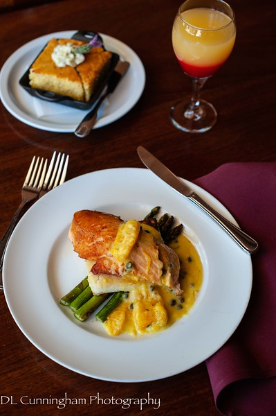 Kitchen 428 - Pan seared organic farmed salmon on white polenta, delta asparagus, citrus caper sauce and a sunrise mimosa