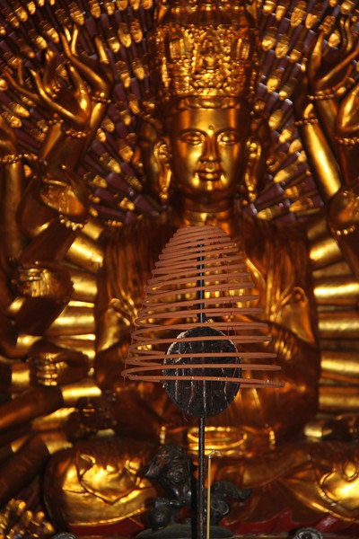 Temple incense and a thousand arm Buddha