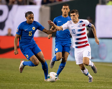 Christian Pulisic #10, Shermaine Martina #15