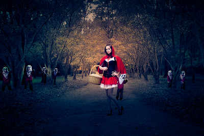 Wolves stalking Red Riding Hood.