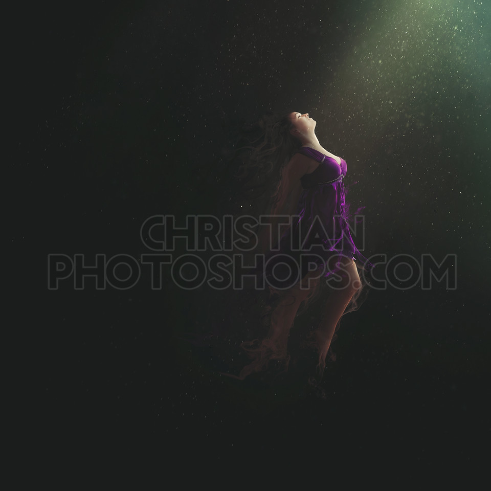 Woman jumping in darkness