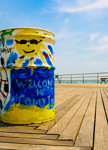 Close up of a garbage can on the board walk of Coney Island, Brooklyn, New York.