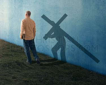 Man walking with Cross shadow