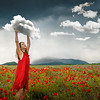Beautiful young girl on field of Poppies.