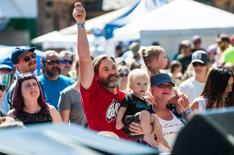 Justin Palmer dances with his 2 year old son, Owen, during a performance by the band March Fourth during the Blues, Brews, and BBQ Festival at Snowbasin Resort in Huntsville on June 19, 2016.