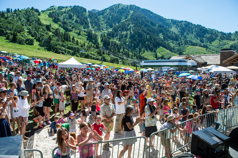 Canopies, umbrellas, and people fill the bunny slopes of Snowbasin Resort for the Blues, Brews, and BBQ Festival held every Sunday afternoon throughout the summer on June 19, 2016 in Huntsville.