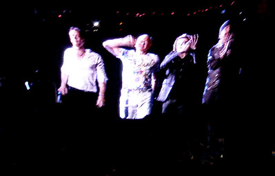 The boys head off stage...big screen shot
