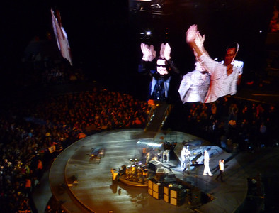 The boys head off stage...big screen shot above, band just below.