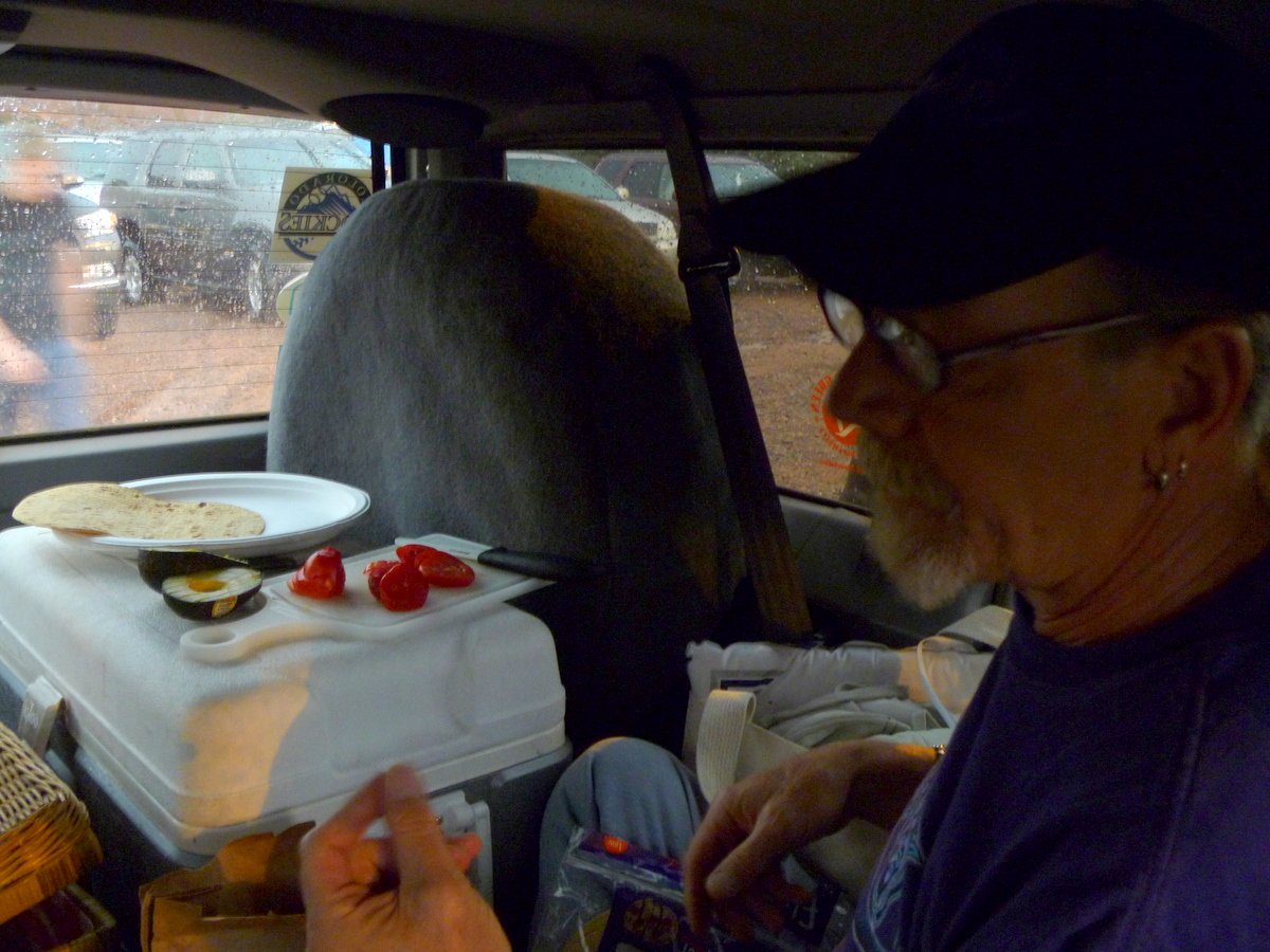 Making dinner is moved inside the Jeep.