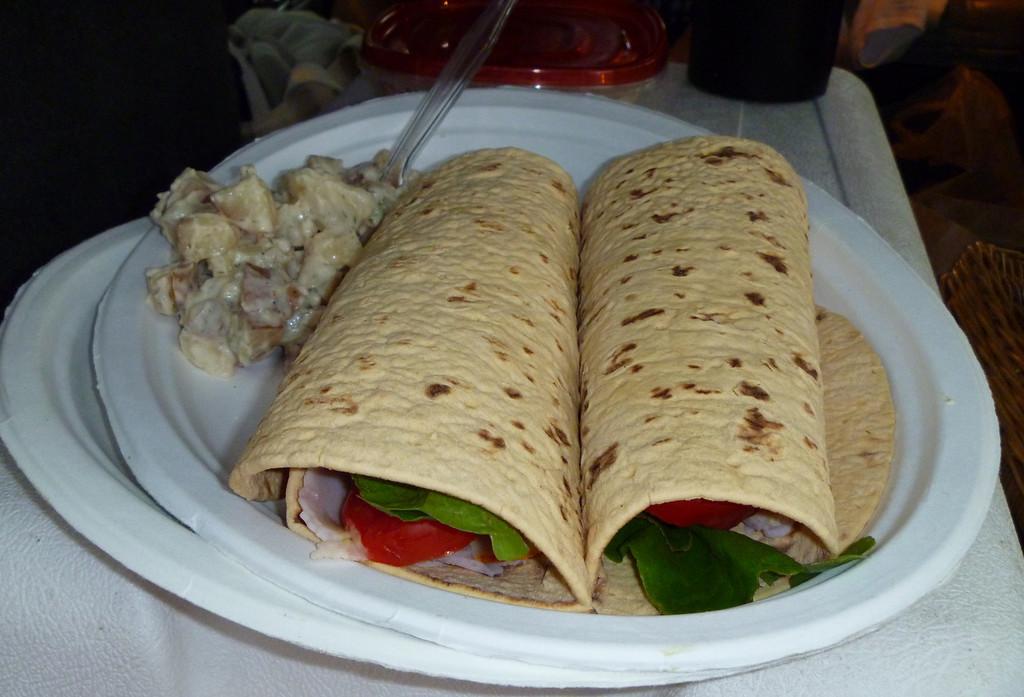 Turkey, avocado, tomato, garden lettuce, Dijon mustard wraps with homemade potato salad.  Yum!