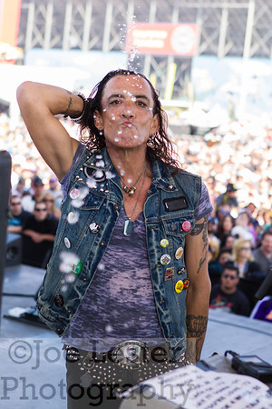 An onstage moment with Stephen Pearcy/RATT at the NASCAR event in Fontana,CA. 2013 *ALL ACCESS*