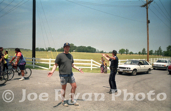 Our friend being turned away by the police<br /> Deer Creek Music Center in the back left<br /> July 3, 1995