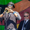Trumpeter Chris Littlefield (and bassist Chris Stillwell, rear) during KDTU's set on the Congo Square stage, April 26.