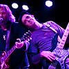 Bassist Carl Dufrene acting out a lyric about leaning on a shoulder as Anders Osborne sings that lyric duirng his set at the Sounstage in Baltimore, MD (2-10-12).