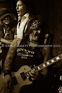 L.A. Guns at Weber's Place in Los Angeles.  Original bass player, Kelly Nickels [background], singer Phil Lewis [center] and guitarist Stacy Blades.  Photo by Erin Suggett for L.A. Guns.  February 2012 - All Rights Reserved